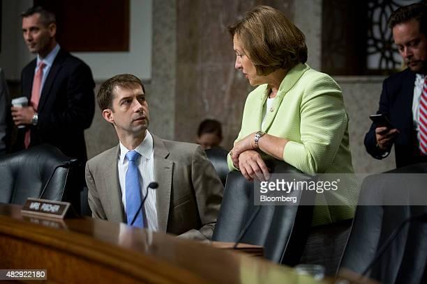 Senator Tom Cotton a Republican from Arkansas left talks to Senator Deb Fischer a Republican from Nebraska before a Senate Armed Services Committee...