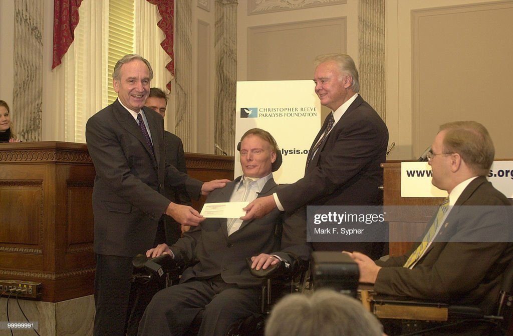 Senator Tom Harkin (D-IA) and Rep. Bill Young (R-FL) presented Christopher Reeve with a $2 million check for his Paralysis Resource Center. Rep. Jim Langevin (D-RI), at right, also spoke at the event with Reeve.
