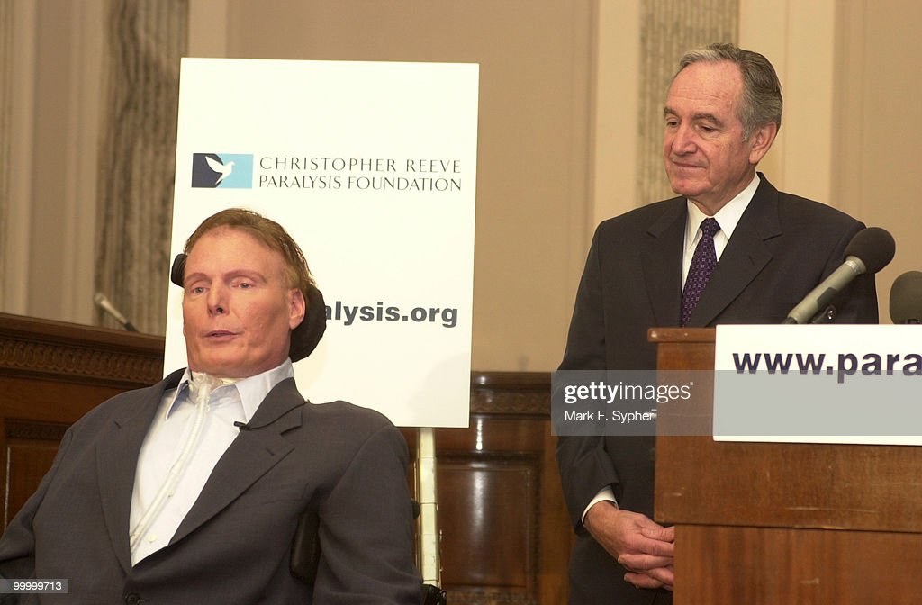 Senator Tom Harkin (D-IA) listens to Christopher Reeve on Wednesday before Reeve accepted his $2 million check from Secretary of Health and Human Services, Tommy Thompson. Ther money is for the Christopher and Dana Reeve Paralysis Resource Center (PRC).