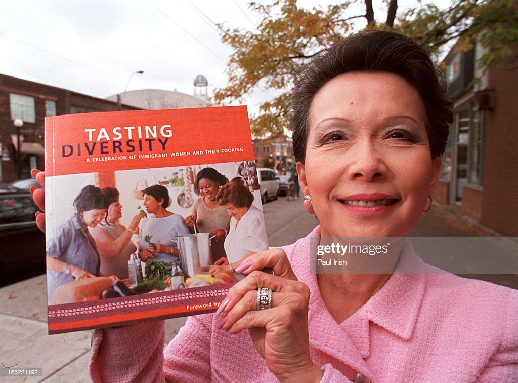 Senator Vivienne Poy holds cookbook that she has contributed with proceeds going to the United Way a : News Photo