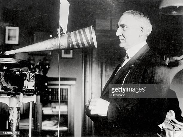 Senator Warren Harding campaigning in 1920 making a phonograph record of a speech in his office Photograph