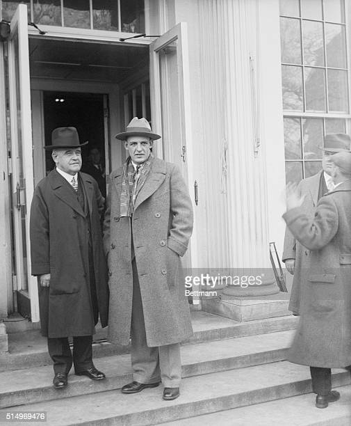 Senator William Brown McKinley of Illinois and coach Red Grange of the Chicago Bears visit the White House.