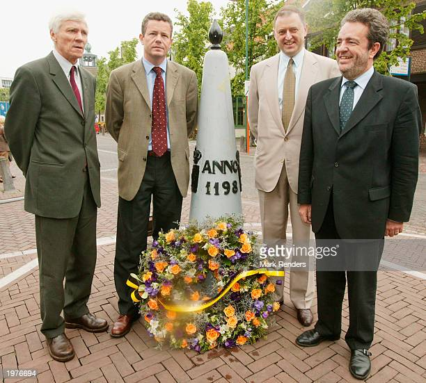 Senator Wim Verreycken Chairman Frank Van Heche Senator Johan Demol and Senator Gerolf Annemans of Vlaams Blok pose with a wreath for Dutch...