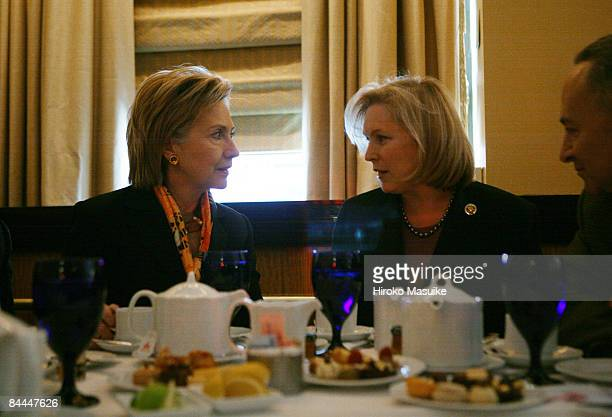 Senatordesignate Rep Kirsten Gillibrand and US Secretary of State Hillary Rodham Clinton look to each other during a lunch meeting with New York Gov...