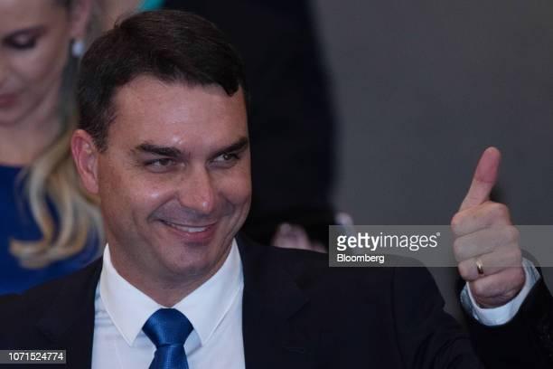 Senatorelect Flavio Bolsonaro a Social Liberal Party member of Rio de Janeiro state arrives during a ceremony confirming Brazils PresidentelectJair...
