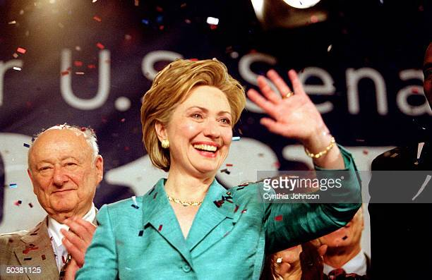Senatorelect Hillary Rodham Clinton celebrating her victory at election night party at Grand Hyatt with Ed Koch behind her