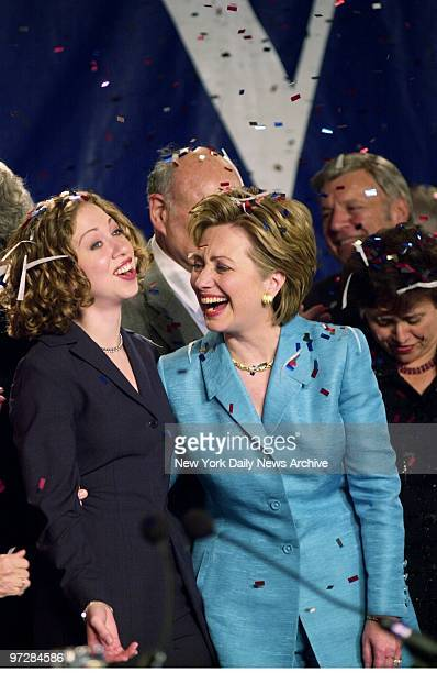 Senatorelect Hillary Rodham Clinton shares a laugh with daughter Chelsea as the two are showered with confetti during victory celebration at the...