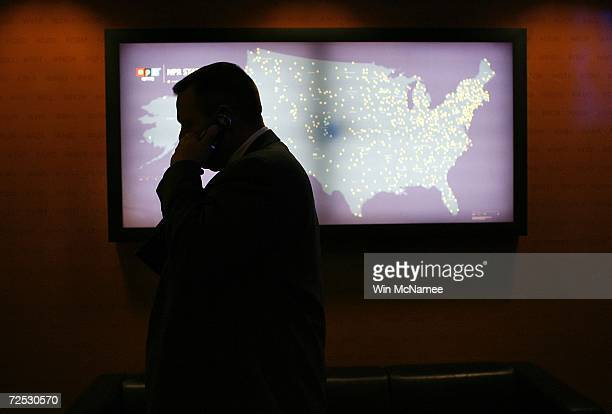 S Senatorelect Jon Tester speaks on his mobile phone in the lobby of the National Public Radio offices during his first trip to Washington since the...