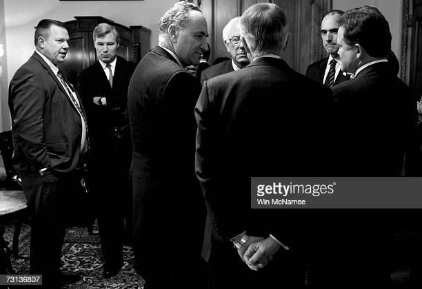 Senatorelect Jon Tester speaks with Senatorelect Sheldon Whitehouse as Democratic Leader Sen Harry Reid speaks with Sen Charles Schumer and incoming...