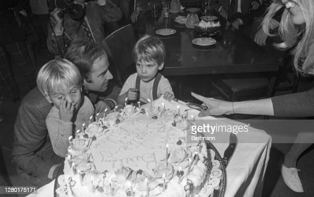 Senator-elect Joseph Biden cut his 30th birthday cake at a party in Wilmington, November 20th. His sons, Hunter and Beau, wait for the first piece....