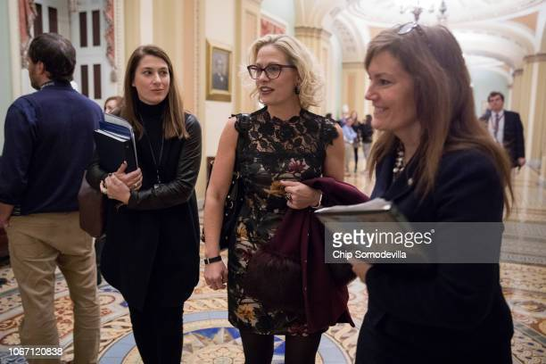 S Senatorelect Kyrsten Sinema walks through the US Capitol November 13 2018 in Washington DC Sinema narrowly defeated her opponent Rep Martha McSally...