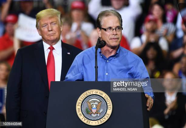 US senatorial candidate Mike Braun speaks during a campaign rally with US President Donald Trump at Ford Center in Evansville Indiana on August 30...