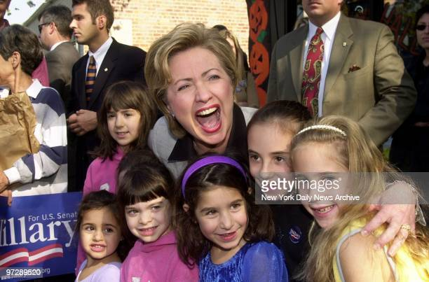 Senatorial hopeful Hillary Rodham Clinton shares a laugh with some future voters outside the Dolphin Bookshop during a campaign stop in Port...