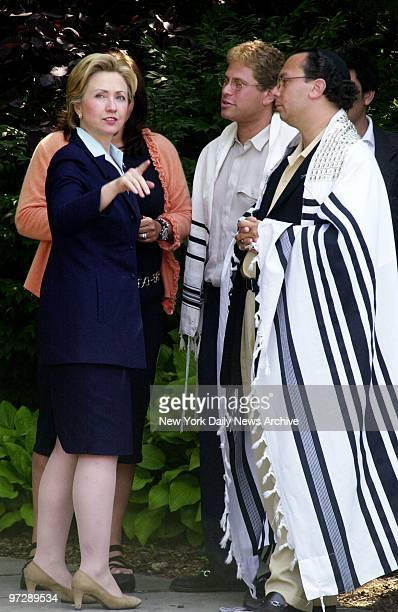 Senatorial hopeful Hillary Rodham Clinton speaks with Rabbi Marc Schneier and another temple member after attending services at Hampton Synagogue in...