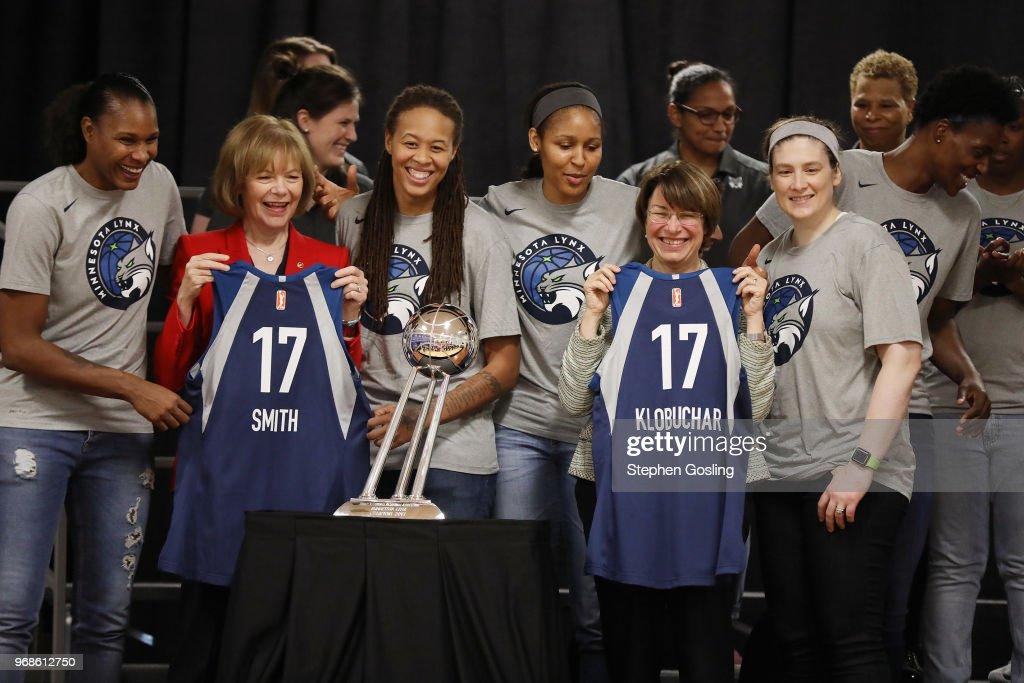 US Senators, Amy Klobuchar and Tina Smith pose for a photo with the Minnesota Lynx during a press conference after a community event giving away shoes and socks at Payne Elementary in Washington, DC on Jun 6, 2018.