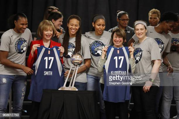 Senators Amy Klobuchar and Tina Smith pose for a photo with the Minnesota Lynx during a press conference after a community event giving away shoes...