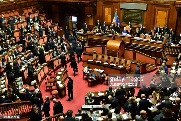 Senators arrive at the Senate in Rome on March 23 for the first session after the March 4 vote Italy's deadlocked parliament reconvenes on March 23...