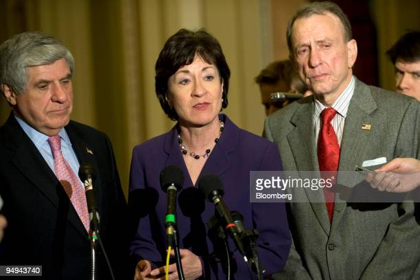 Senators Ben Nelson a Democrat from Nebraska left Susan Collins a Republican from Maine center and Arlen Specter a Republican from Pennsylvania speak...