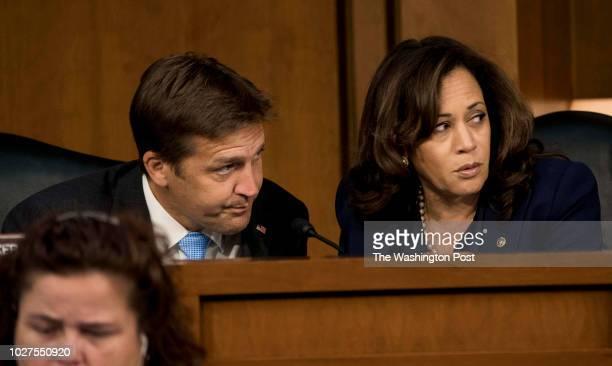 Senators Ben Sasse and Kamala Harris speak quietly during the Supreme Court nominee Brett Kavanaugh's confirmation hearing in the Senate Judiciary...