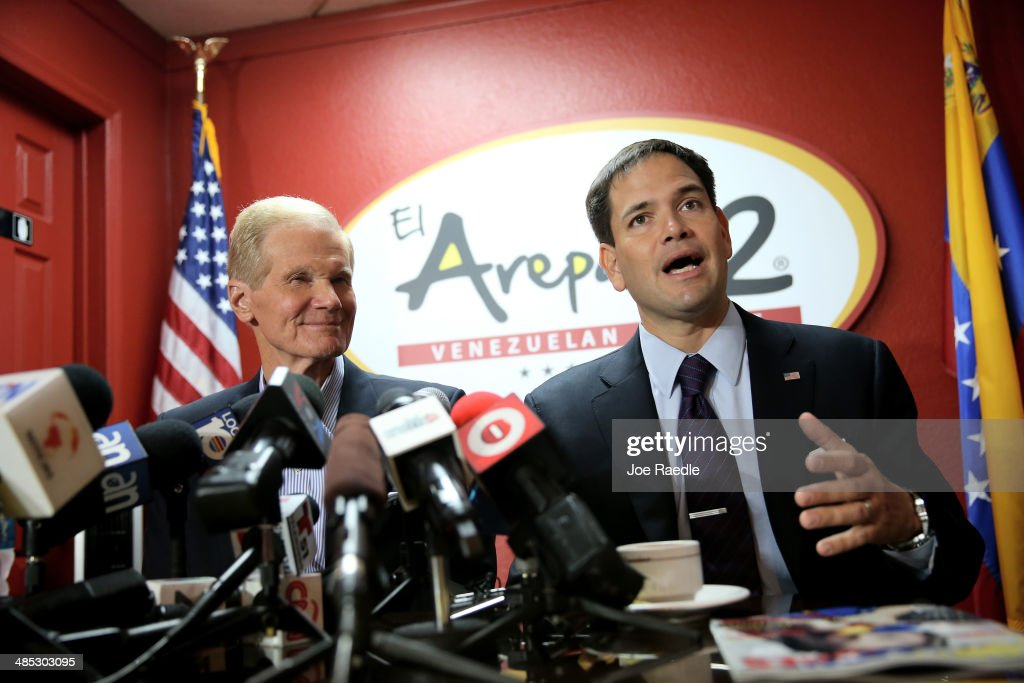 U.S. Senators Bill Nelson (D-FL) (L) and Marco Rubio (R-FL) hold a press conference to show support for the Venezuelan community at the El Arepazo 2 Restaurant on April 17, 2014 in Doral, Florida. The Senators spoke about the need for the United States to support the opposition in Venezuela against Venezuelan President Nicolas Maduro.