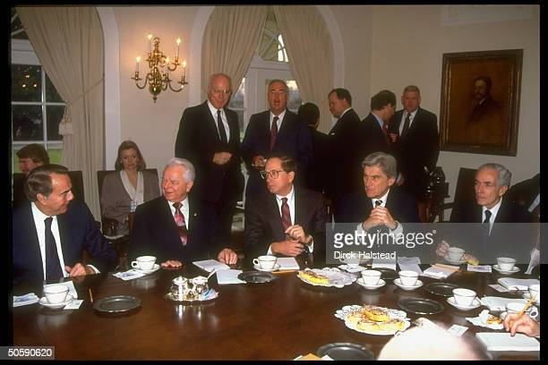 Senators Bob Dole Robert Byrd Sam Nunn John Warner and Claiborne Pell during a meeting in the White House Cabinet Room on the Gulf crisis with...