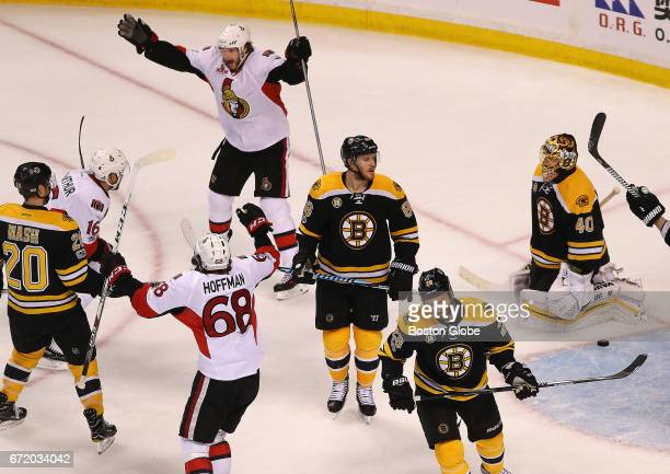 Senators' Bobby Ryan top celebrates with Clarke MacArthur left after his game winning overtime goal as Senators Mike Hoffman moves in to hug him...