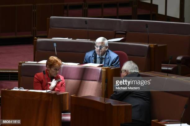 Senators Brian Buston Pauline Hanson and Barry O'Sullivan in discussion as they vote in favour of amendments to the marriage equality bill introduced...