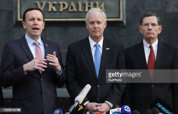Senators Chris Murphy Ron Johnson and Senator John Barrasso make a statement to the press following their meeting with President Zelensky at his...