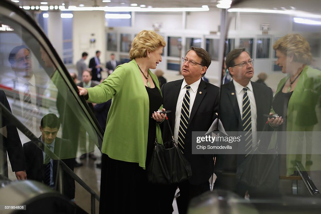 Senators Debbie Stabenow (D-MI) (L) and Gary Peters (D-MI) head for the weekly Republican Democratic policy luncheon at the U.S. Capitol May 17, 2016 in Washington, DC. Leaders from both sides of the aisle met behind closed doors for their weekly policy meetings.