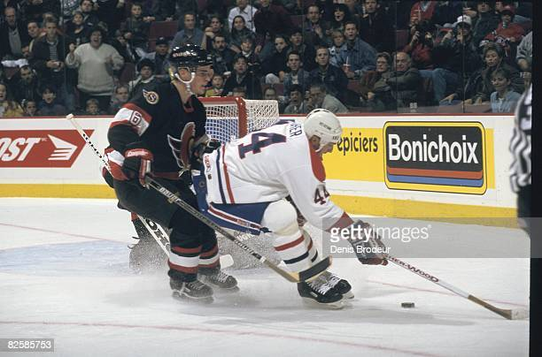 Senators defenceman Wade Redden steers Montreal forward Stephane Richer away from Ottawa net in a game at the Molson Centre during the 1996-97 season