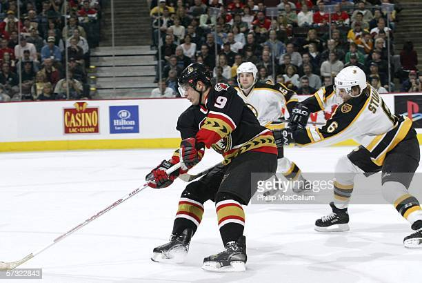 Senators forward Jason Spezza makes a move around Bruins defenseman Brad Stuart during the first period on April 11 2006 at the Scotiabank Place in...
