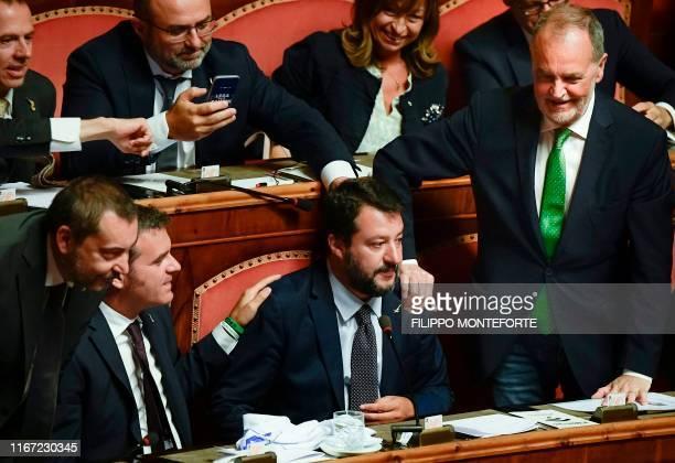 Senators Gian Marco Centinaio and Roberto Calderoli congratulate Head of the farright Northern League party current Italian Senator and former...