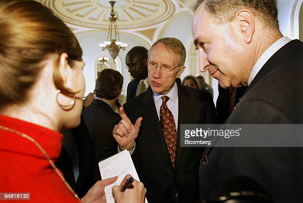 Senators Harry Reid center and Charles Schumer speak to a reporter at the conclusion of a news conference with the Democratic leadership on Capitol...