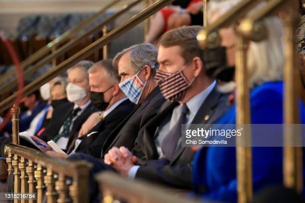 Senators, including Sen. Michael Bennet , Sen. Jeff Merkley and Sen. Dan Sullivan , listen to U.S. President Joe Biden addresses a joint session of...