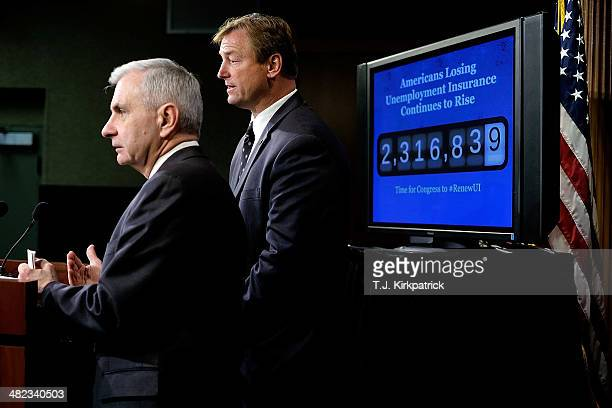 Senators Jack Reed left and Dean Heller standing in front of a screen showing an increasing number count to represent the number of Americans losing...