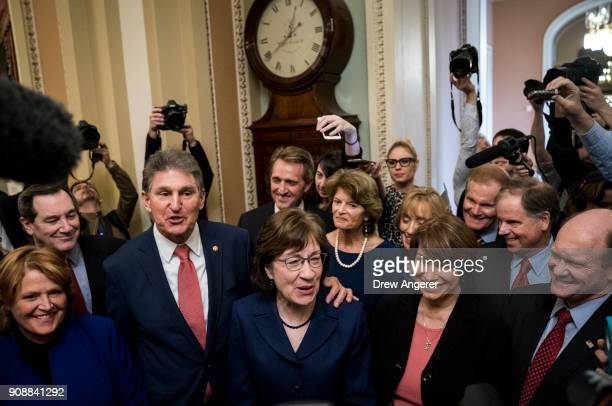 Senators Joe Manchin and Susan Collins lead a group of bipartisan Senators as they speak to reporters after the Senate passed a procedural vote for a...