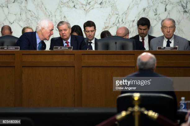 Senators John Cornyn Lindsey Graham and committee chairman Chuck Grassley listen to testimony from William Browder chief executive officer of...