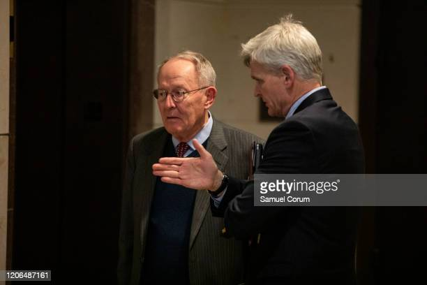 Senators Lamar Alexander and Bill Cassidy talk as they leave a briefing for Senators by officials from the Department of Homeland Security Federal...