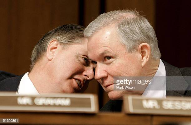 S Senators Lindsey Graham speaks with US Senator Jeff Sessions during a Judiciary Committee confirmation hearing for Alberto R Gonzales January 6...