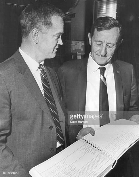 FEB 1 1967 Senators Look Over Budget Book From Gov John Love's Office Sen Allen Dines DDenver left is with Sen Sam Taylor DWalsenburg