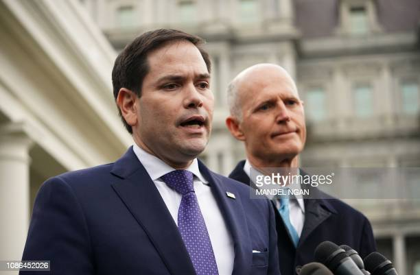 US senators Marco Rubio and Rick Scott speak to reporters after a meeting with US President Donald Trump on Venezuela outside of the West Wing of the...