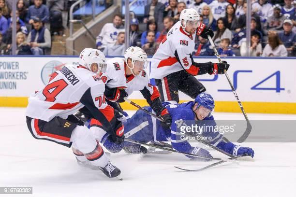 TORONTO ON FEBRUARY 10 Senators Mark Borowiecki Ryan Dzingel and Cody Ceci collapse on Tyler Bozak of the maple Leafs during the 3rd period of NHL...
