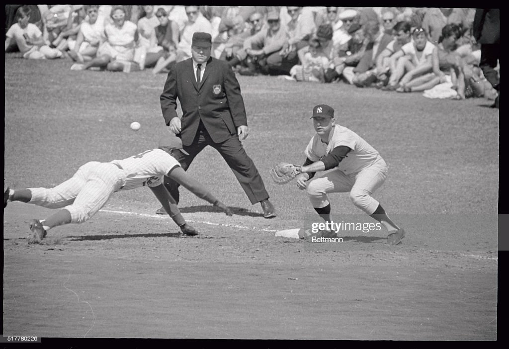 Senators Outfielder Fred Valentine Beats The Ball Back To First Base Where  Yankee Slugger Mickey Mantle