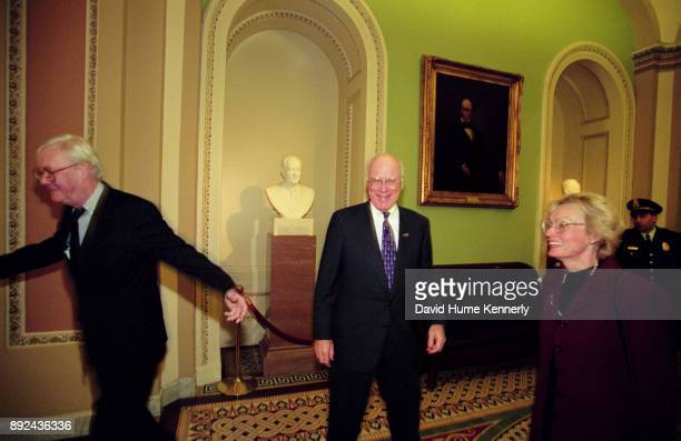 Senators Patrick Moynihan and Pat Leahy with Leahy's wife Marcelle Pomerleau in the hallways of the US Capitol Building during the Senate Impeachment...