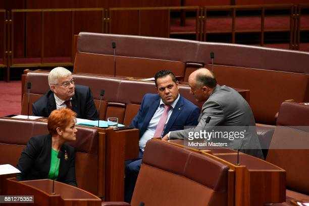 Senators Pauline Hanson Brian Burston Peter Georgiou and Eric Abetz in discussion during the dabte of the marriage equality bill in the Senate at...