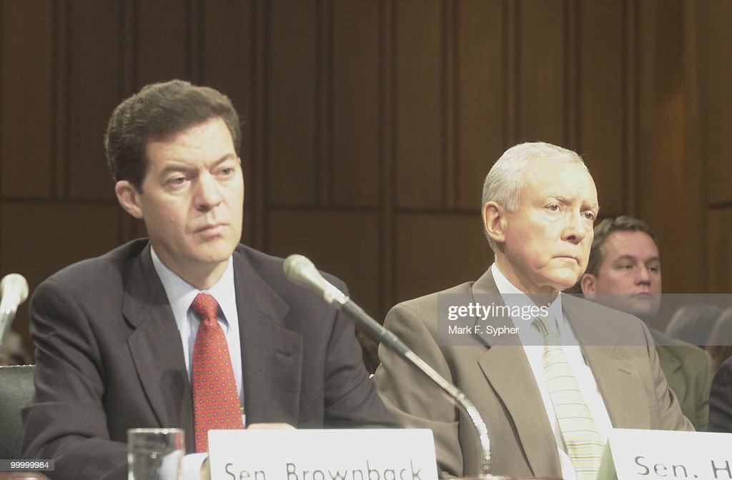 Senators Sam Brownback (R-Kan.), left, and Sen. Orrin Hatch (R-Utah) listen to Senator Gordon Smith's (R-Ore.) testamony in support of stem cell research.