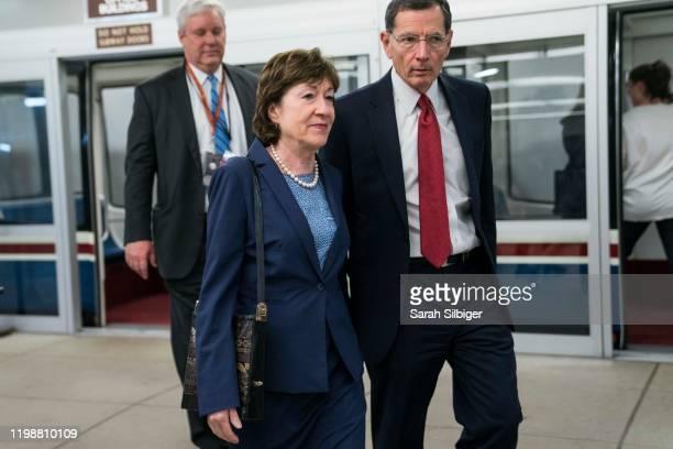 Senators Susan Collins and John Barrasso walk from the Senate subway to the Senate chamber to cast a vote in the Senate impeachment trial of...