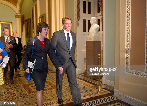Senators Susan Collins RME and Jeff Flake RFL arrive for a meeting of Senate Republicans on a solution for the pending budget and debt limit impasse...