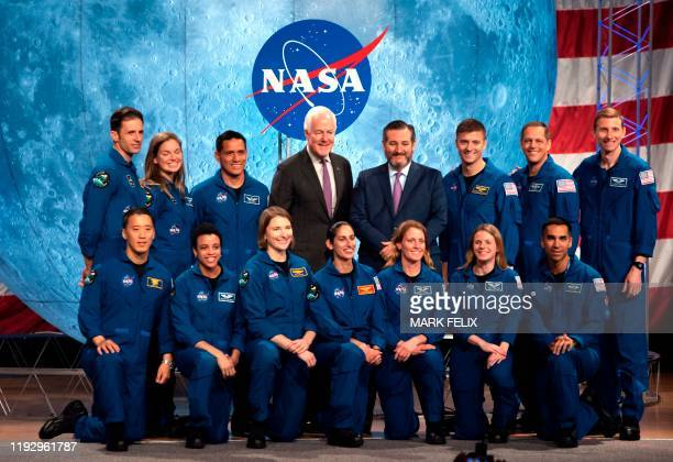 US Senators Ted Cruz and John Cornyn pose with Nasa and Canadian Space Agency graduating astronauts during the ceremony at Johnson Space Center in...