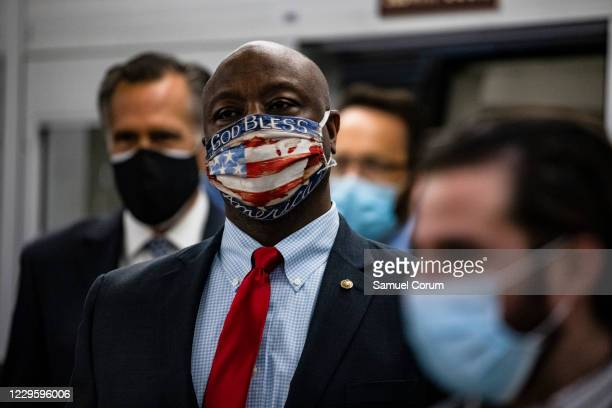 Senators Tim Scott and Mitt Romney step off the Senate subway on their way to a vote in the Senate at the U.S. Capitol on November 12, 2020 in...